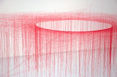 Silk Vortex / For over two decades japan­ese artist Akiko Ikeuchi has been cre­at­ing room-​​sized vor­tices of silk, tying hun­dreds of small knots in coloured thread to form elab­o­rate gallery instal­la­tions.