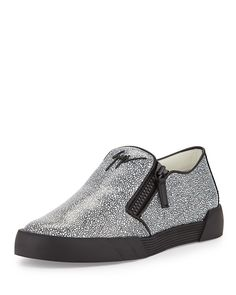 Giuseppe Zanotti stingray-embossed sneaker in calf leather. Round toe. Embossed logo at front. Dual-side zip detail. Slip-on style. Leather lining and insole. Rubber outsole. Made in Italy.