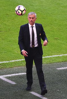 Manager of Manchester United Jose Mourinho catches the ball during The FA Community Shield match between Leicester City and…