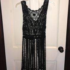 Crocheted long vest Long, black, crochet vest that ties below the bust line and ends right at the knee Sweaters