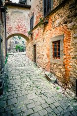 Cobblestone Alley in Ancient Tuscan Village, Italy stock photo