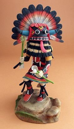 SOUTHWESTERN: The Broadface Kachina, Wuyak-kuita. Within Hopi religion, the kachinas are said to live on the San Francisco Peaks near Flagstaff, Arizona. The most important Hopi kachinas are called wuya.