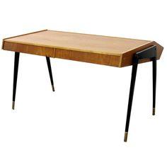 A Carlo De Carli laminated & ebonized wood desk circa 1950