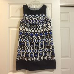 Patterned dress Size medium, fits like small. Mid thigh length. Lined. Tear in inner lining (shown in picture) but not visible. Mark Dresses