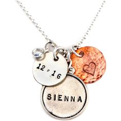 Personalized sterling silver necklace with hand-stamped name and date pendants with a copper heart disc and Swarovski crystal accent