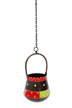 This multicoloured handpainted Lota is a new and ethnic concept in modern households. It comes with a chain hence it can be hung as well as kept inside the house. Beautiful craftings and a bronze finish , make its surroundings aesthetically pleasing.