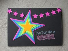 handcrafted greeting card ... black cardstock with die cuts in neon bright colors ... graduated size star die cuts  stacked pyramid style but not evenly ...  like the row of little stars across the top ... fun card!!