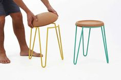 Made of lacquered steel and cork, the Sputnik stool and table are designed by Sputnik Design Studio