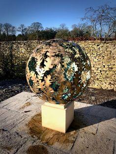 A diameter solid brass Garden sculpture sphere. The design is based on a Hydrangea flower, the choice of my client. David Murphy, Hydrangea Flower, Flowers, Garden Sculptures, Steel Sculpture, Solid Brass, Globe, Leaves, Design