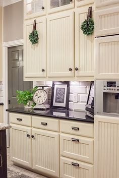The Pool Family Kitchen by Dear Lillie.  Plan on putting a few wreaths on my cabinets.  So cute :)