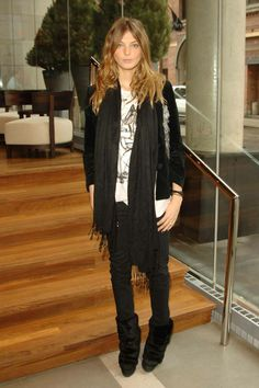 Daria Werbowy; dark pants/boots; white contrasting with black layered top