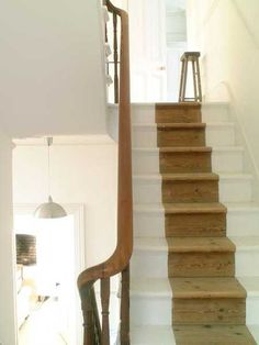 wooden stairs painted half white