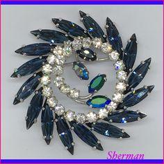 Sherman wreath brooch sapphire blue , Clear Swarovski .