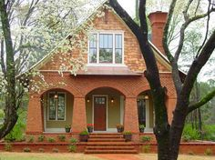 Look at the details in this house. Gorgeous! Brick and shingle cottage in Georgia | hookedonhouses.net