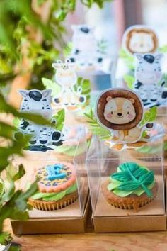 Take a look at the gorgeous safari-themed cupcakes in transparent individual boxes decorated with safari animals at this modern safari birthday party!! See more party ideas and share yours at CatchMyParty.com