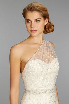 Sweetheart neckline with a sheer one shoulder strap.