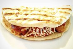 """Presenting 🎤 .... """"Chick'n parm Panini! 👏 👏 This recipe, compliments of vegan foodie @TK_is_the_1 on Instagram, uses vegan Kontos Pre-Grilled Panini Bread, along with tomato sauce, #Gardein Plant-Based Chicken Tenders and Moocho Dairy-free Mozzarella style shreds. Looks like a great #MeatlessMonday Option! Panini Bread, Grill Panini, Pita Bread, Grilled Flatbread, Grilled Sandwich, Food Inc, Soy Protein, Clotted Cream, Chicken Tenders"""