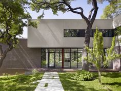 """Residential Architecture: West Lake Hills Residence by Specht Harpman: """"..On a densely tree-covered site in the Austin, Texas, USA, exurb of West Lake Hills,Specht Harpmanwas tasked with the renovation and expansion of a modest 1970′s house. Much of the original internal structure was maintained, but the alterations sought to erase all visible traces of the original house..The primary goal of the new renovation and expansion was to preserve all of the site's large twisting Live Oak trees…"""