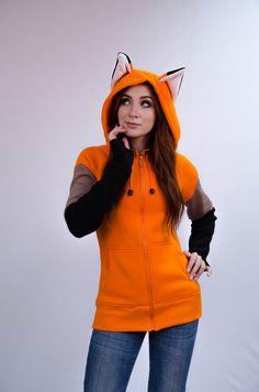 Bête à capuche avec oreilles - Fox Le hoodie « Fox » est esprit de diableries et de plaisir. Il est tout à fait ordinaire hoodie, mais il a des oreilles ! Mettre la hotte sur et dans le monde devenir plus britly. Le hoodie pour ceux qui supposent que « si la laideur ne peut pas être
