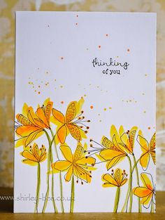 "She said she ""sloshed some Distress Inks across some flower images.""  The image is from Penny Black 3817K Tigress."