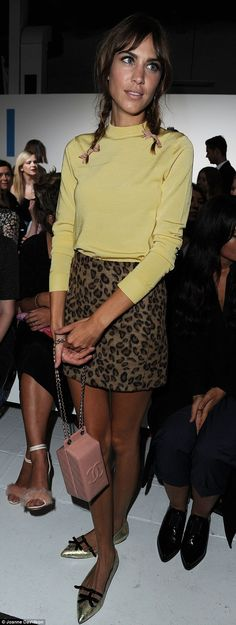 Cute as a button: The presenter finished off her look with a lime green turtle neck jumper and a leopard print mini-skirt
