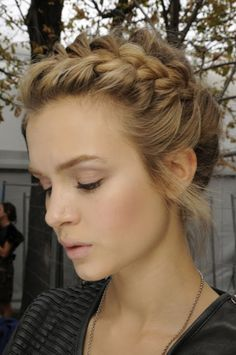 "side part and braid about 4"" of your hair loosely for the messy look;) tie it with a ponytail, and pull the rest of your hair over it into a bun"