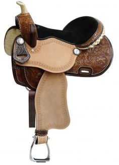 "ONE OF A KIND 16"" Barrel saddle with floral tooling features ombre oiled floral tooled skirts, pommel and cantle that are accented with silver studs. Rough out fenders and jockies are accented with a"