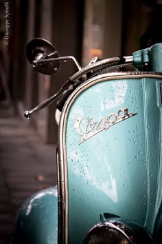 I have always loved Vespas and this is my favorite color... add some rain, which is also another favorite of mine, and this is pretty much perfection <3 Great photo!