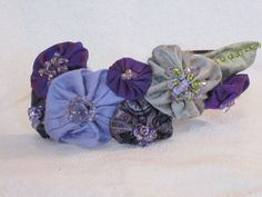 Handmade Headband  Beaded Silk Flowers with by nedaoriginals, $32.00  I'm back to making headbands.  Too bad I have only one head!!
