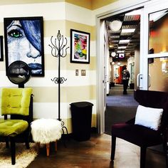 Striped walls, punchy accent pieces, beautiful artwork. #solasalons