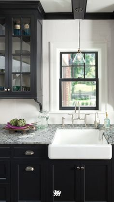 No modern farmhouse look is complete without an apron sink, a design that's a classic for a reason. A deep basin means there's space for all your dishes — and then some! [Featured Design: Praa Sands™]