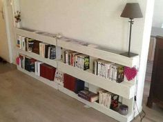 So simple wall bookshelf from white painted wooden pallets.