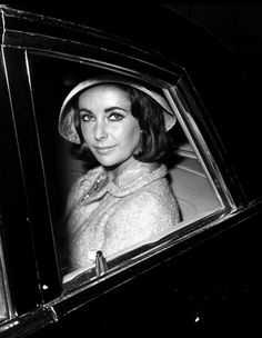 Elizabeth Taylor wearing suit and hat by Chanel. Paris, c.1960. Series of black & White prints...