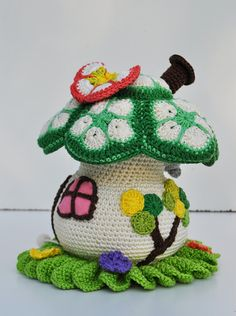 Crochet African flower roofed toadstall house. (Inspiration).