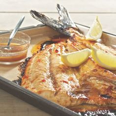 South African Snoek Fish With Apricot Jam _ Recipe from Martin van Deventer _ Snoek is delicious with a touch of sweetness and a mild spice like cumin. Try it in the oven or braai it outside. Braai Recipes, Fish Recipes, Seafood Recipes, Recipies, Fish Dishes, Seafood Dishes, Salted Caramel Fudge, Salted Caramels, South African Recipes