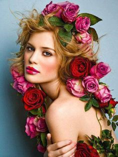 floral headdress of pink and red roses