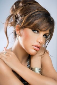 Updo Hairstyle With Full Bangs   Trends presents Modern messy updo hairstyle with light curls 2010