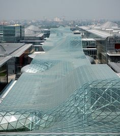 """Top Five Facades From Guardian SunGuard -  """"Milan Trade Fair """" - We're not exactly sure how much glass went into Massimiliano and Doriana Fuksas' Milan Trade Fair, but judging from the 1300-meter long, 32-meter wide glazed canopy that runs through the heart of the project, there's a whole lot. The campus consists of series of pavilion structures and circulation routes woven together by monumental whorls of glass..."""