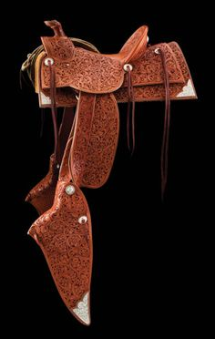 saddle by Cary Schwarz also features the work of four other TCAA members. Chuck Stormes made the saddletree, Scott Hardy fabricated the sterling-SR