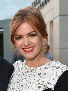 Isla Fisher | 31 Celebrity Haircuts That Might Tempt You Into Getting Bangs