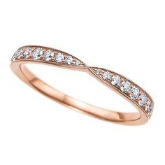 Tiffany Harmony™ rose gold wedding band with diamonds.