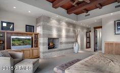 master bedroom with fireplace built into the wall - 41188 N 102ND Place, Scottsdale, AZ, 85262