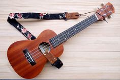A personal favorite from my Etsy shop https://www.etsy.com/listing/271310399/black-fabric-flower-ukulele-strap-3in1