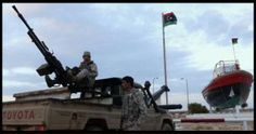 TRIPOLI: Libya's navy and pro-government militias have dispatched boats to a port held by armed protesters to stop a North Korean-flagged ta...