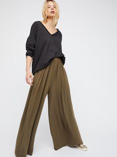 Love Me Wide Leg | Soft pants with a high rise and a dramatic wide leg for an ultra chic and retro-inspired feel. Ribbed design. Stretchy wide smocked band at the waist for an easy fit. American made.