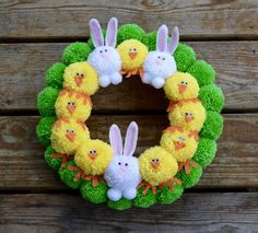 Easter pom pom wreath with rabbits and chicks, bright Easter pom pom wreath, pom pom Easter wreath Simple craft projects with pompoms for Christmas - Ninas Apartment Lifestyle Block .Simple craft projects with pompoms for Pom Pom Wreath, Diy Wreath, Pom Poms, Bunny Crafts, Easter Crafts For Kids, Easter Decor, Unicorn Crafts, Spring Crafts, Holiday Crafts