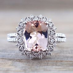 Cushion Cut Morganite set on a vintage inspired white gold diamond halo ring…