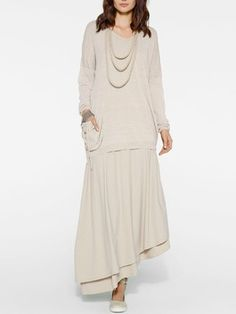 Double layer long skirt with asymmetric hem and pullover in a very light beige by Sarah Pacini