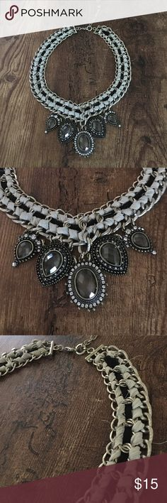 Chandelier crystal ribbon necklace A wow piece! This statement necklace has a gold chain with black and grey ribbon woven through it. Adorned with five large hanging crystals and rhinestone accents 💖💕 LOFT Jewelry Necklaces
