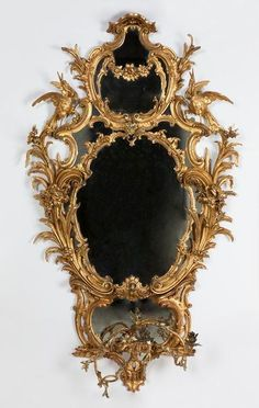 Mirror in an elaborate, oval frame of carved and gilt wood formed of symmetrical floral scroll-work. The carved ornaments divide the mirror into several lights. Ornate Mirror, Vintage Mirrors, Mirror Mirror, Mirror Glass, Classic Furniture, Antique Furniture, Oval Frame, Through The Looking Glass, Victoria And Albert Museum